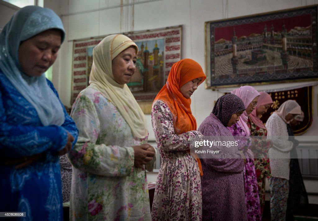Hui Muslim female Imam Yonghua Zheng center prays with other worshippers during the holy month of Ramadan at the women's only Tuanjielu Mosque on...