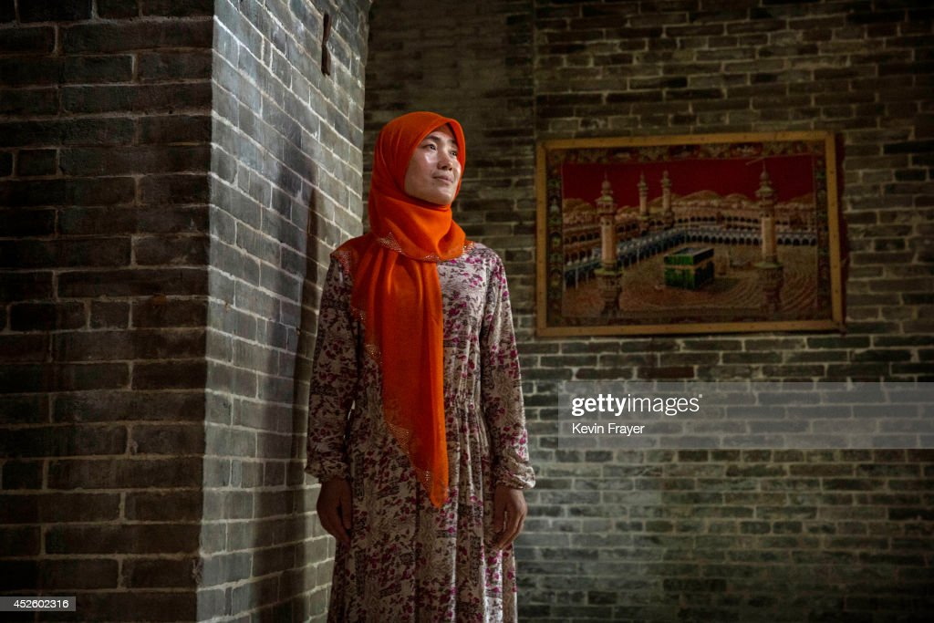 Hui Muslim female Imam Yonghua Zheng poses at the Ming Dynasty era Beida Mosque on July 22 2014 in Qinyang City Henan Province China As part of a...
