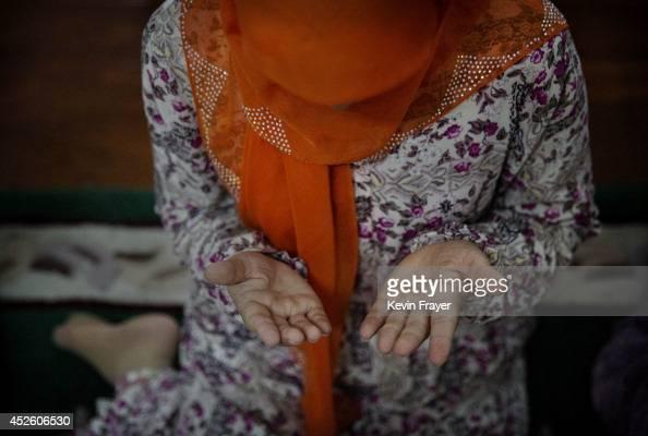 Hui Muslim female Imam Yonghua Zheng prays at the women's only Tuanjielu Mosque on July 22 2014 in Qinyang City Henan Province China As part of a...