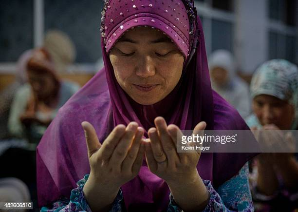 Hui Muslim female Imam Yonghua Zheng prays before breaking her fast during the holy month of Ramadan at the women's only Qingzhenshang Mosque on July...