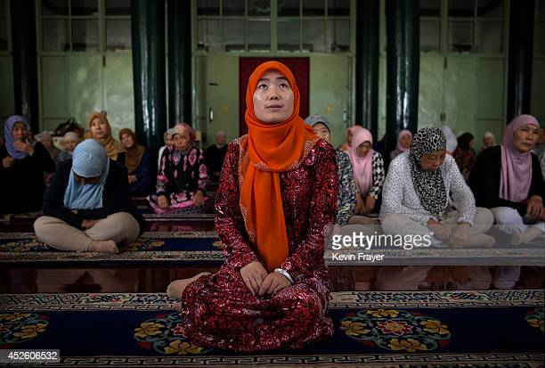 Hui Muslim female Imam Yonghua Zheng sits in front of worshippers as she prepares to lead prayer at the women's only Qingzhenshang Mosque on July 11...