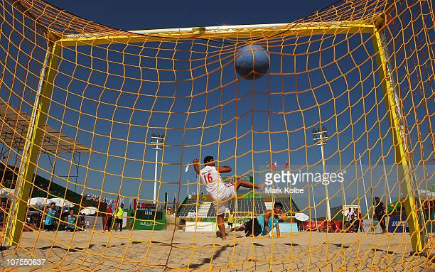HuiHsiung Wang of Chinese Taipei scores a goal in the Beach Handball match against Bahrain at AlMusannah Sports City during day six of the 2nd Asian...