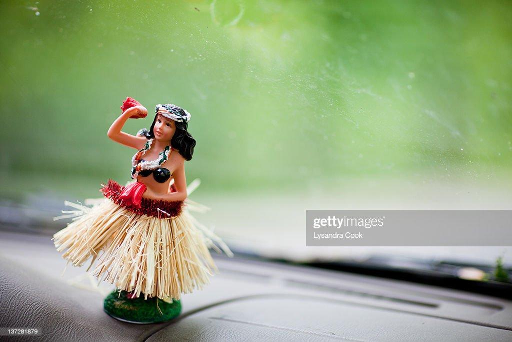 Hula dancer on dashboard : Stock Photo