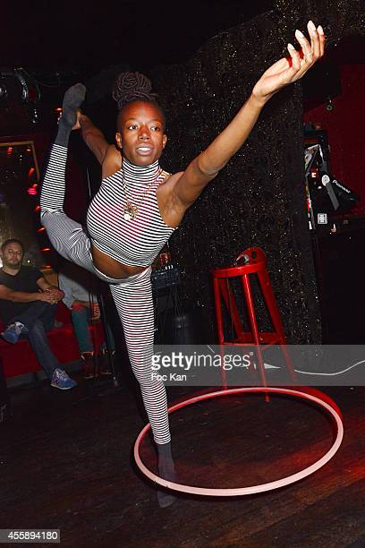 Hula hoop artist dancer Cassandra Momah performs during the Sacha Dahan Show Case Party at Le Baron Club on September 21 2014 in Paris France