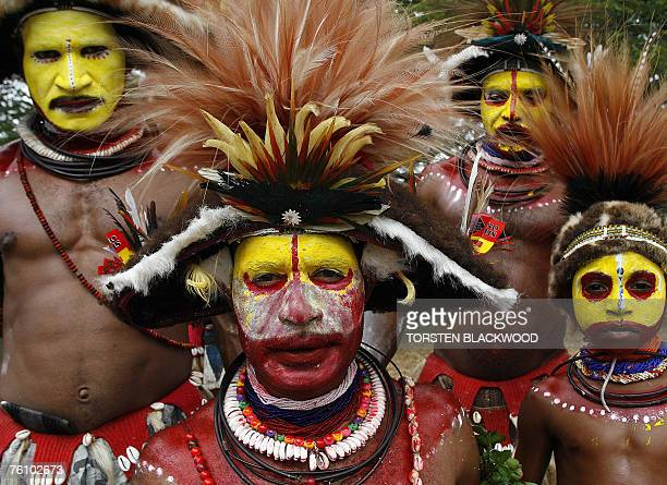 Huli wigmen from Lake Kopiago and Tari display their strikingly decorative woven wigs of human hair adorned with bird of paradise feathers during a...