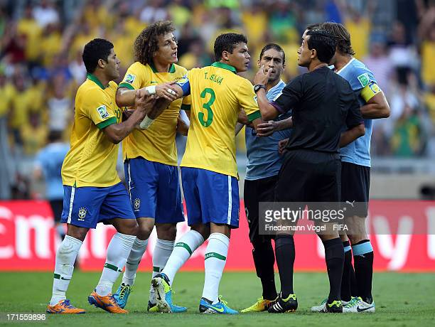 Hulk David Luiz and Thiago Silva of Brazil protest to Referee Enrique Osses of Chile during the FIFA Confederations Cup Brazil 2013 Semi Final match...