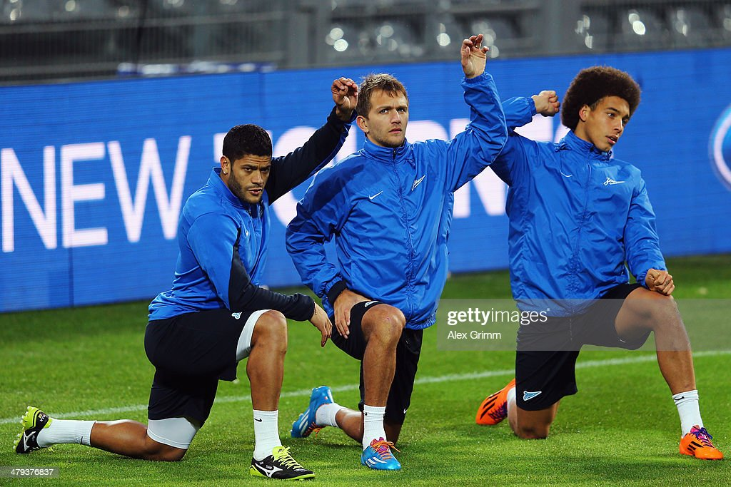 Hulk, <a gi-track='captionPersonalityLinkClicked' href=/galleries/search?phrase=Domenico+Criscito&family=editorial&specificpeople=2484007 ng-click='$event.stopPropagation()'>Domenico Criscito</a> and <a gi-track='captionPersonalityLinkClicked' href=/galleries/search?phrase=Axel+Witsel&family=editorial&specificpeople=4345455 ng-click='$event.stopPropagation()'>Axel Witsel</a> (L-R) attend a Zenit St. Petersburg training session ahead of their UEFA Chamions League Round of 16 second leg match against Borussia Dortmund at Signal Iduna Park on March 18, 2014 in Dortmund, Germany.