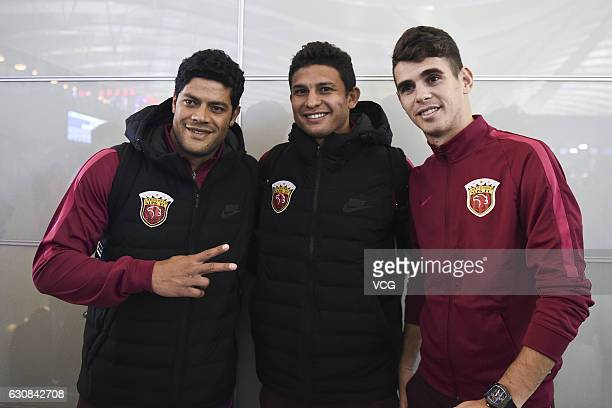 Hulk Elkeson and Oscar of Shanghai SIPG pose for photos at Pudong International Airport prior to their team's departure to the Doha training camp on...