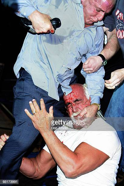 Hulk Hogan and Ric Flair become involved in altercation during a press conference for 'Hulkamania Let The Battle Begin' at Star City on November 18...