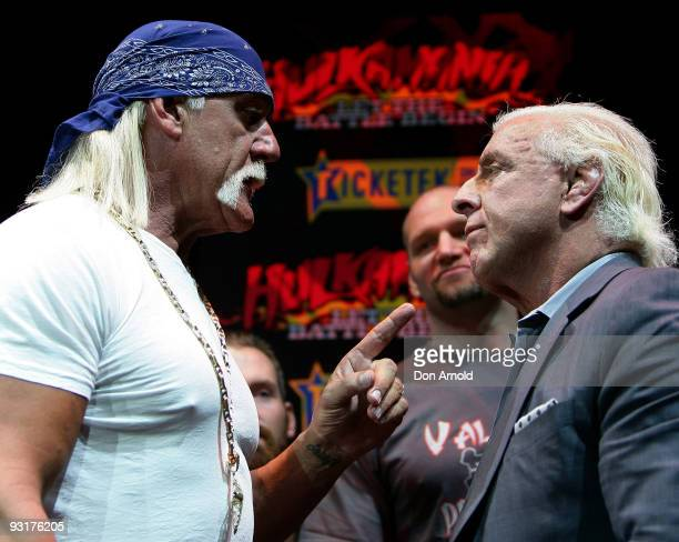 Hulk Hogan and Ric Flair become involved in an altercation during a press conference for 'Hulkamania Let The Battle Begin' at Star City on November...
