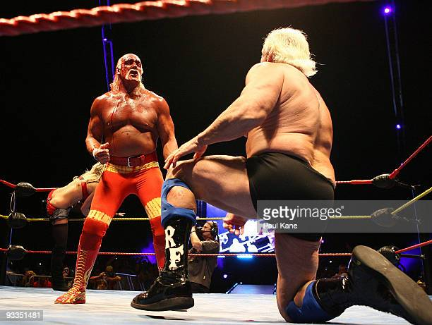 Hulk Hogan gestures to Ric Flair during his Hulkamania Tour at the Burswood Dome on November 24 2009 in Perth Australia