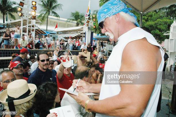 Hulk Hogan signs autographs for fans during the Dale Earnhardt Jr Day at Bayside Market Place in Miami Florida on October 20 2004