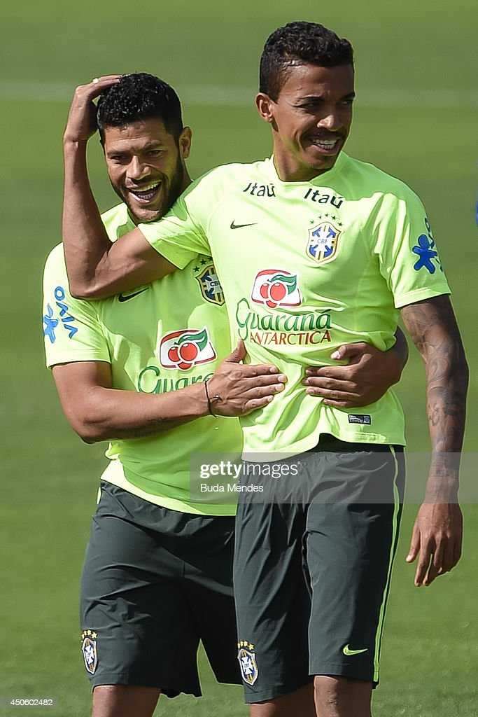 Hulk (L) jokes with Luis Gustavo during a training session of the Brazilian national football team at the squad's Granja Comary training complex, on June 14, 2014 in Teresopolis, 90 km from downtown Rio de Janeiro, Brazil.