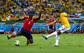 Hulk of Brazil and Cristian Zapata of Colombia compete for the ball during the 2014 FIFA World Cup Brazil Quarter Final match between Brazil and...