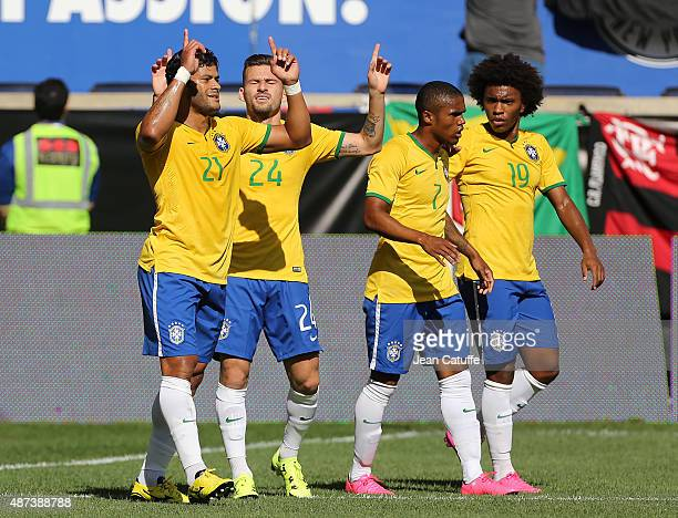 Hulk of Brazil celebrates his goal with Lucas Lima Douglas Acosta and Willian of Brazil during the international friendly match between Brazil and...