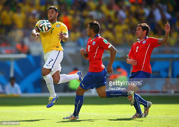 Hulk of Brazil handles the ball before scoring a goal that was disallowed during the 2014 FIFA World Cup Brazil round of 16 match between Brazil and...