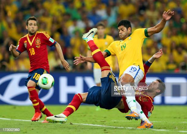 Hulk of Brazil tangles with Sergio Ramos of Spain during the FIFA Confederations Cup Brazil 2013 Final match between Brazil and Spain at Maracana on...