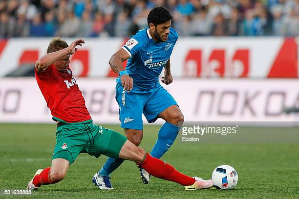 Hulk of FC Zenit St Petersburg and Dmitri Tarasov of FC Lokomotiv Moscow vie for the ball during the Russian Football League match between FC Zenit...