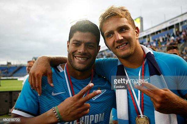 Hulk of FC Zenit St Petersburg and Domenico Criscito of FC Zenit St Petersburg celebrate winning the Super Cup of Russia 2015 match between FC Zenit...