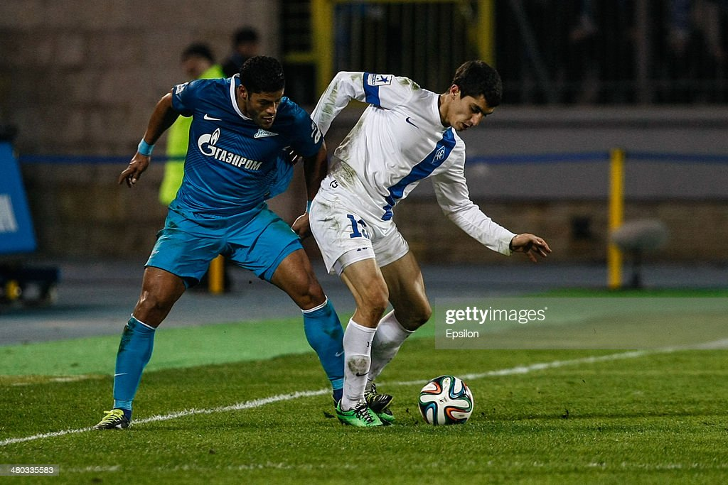 Hulk of FC Zenit St. Petersburg (L) and Ibragim Tsallagov of PFC Krylia Sovetov Samara vie for the ball during the Russian Football League Championship match between FC Zenit St. Petersburg and FC Krylia Sovetov Samara at the Petrovsky stadium on March 24, 2014 in St. Petersburg, Russia.
