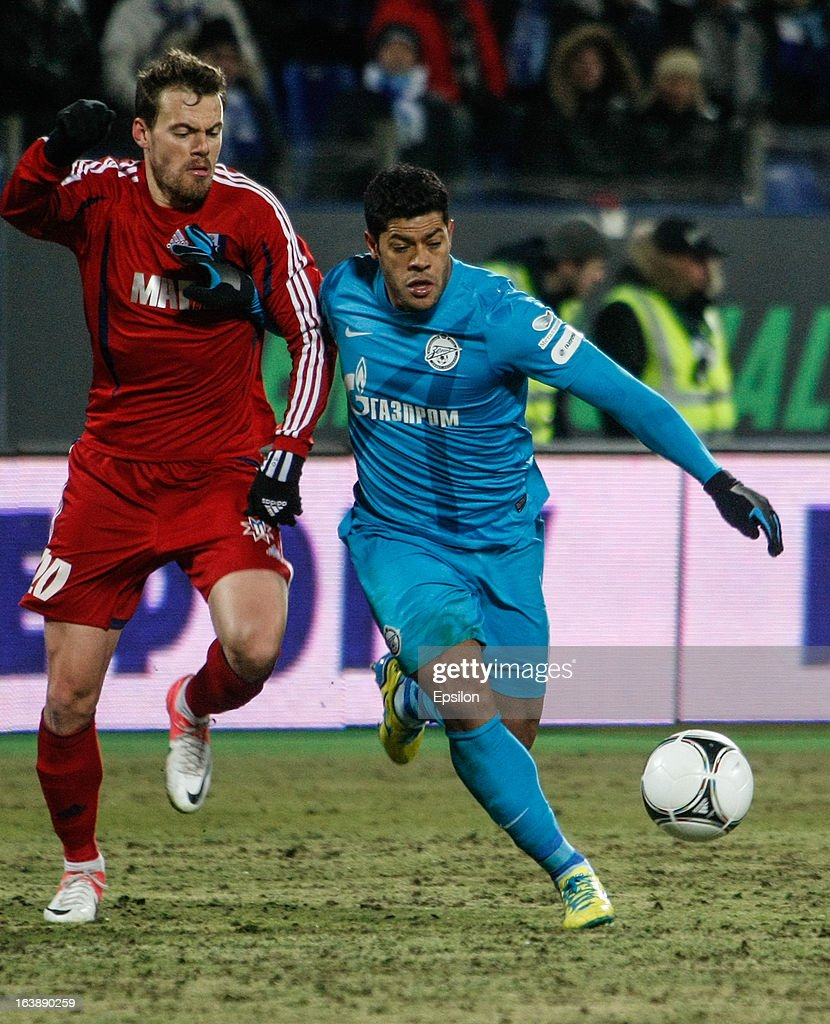 Hulk of FC Zenit St. Petersburg (R) and Tomislav Dujmovic of FC Mordovia Saransk vie for the ball during the Russian Football League Championship match between FC Zenit St. Petersburg and FC Mordovia Saransk at the Petrovsky Stadium on March 17, 2013 in St. Petersburg, Russia.