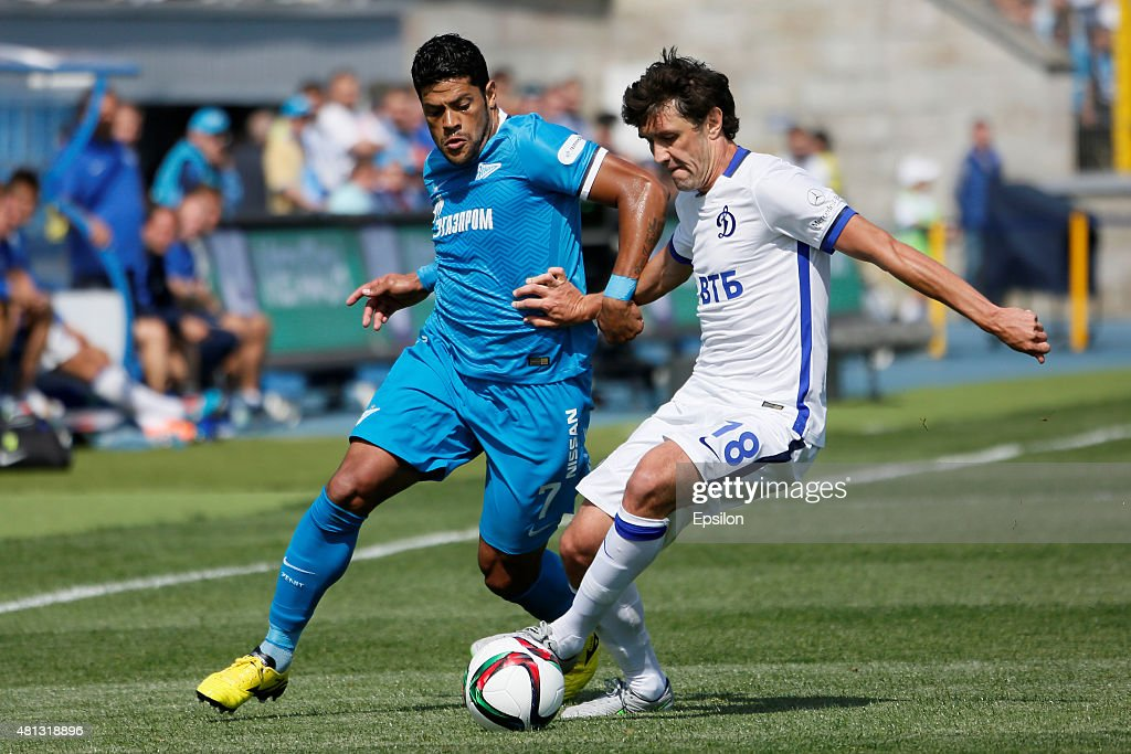 Hulk (L) of FC Zenit St. Petersburg and Yuri Zhirkov of FC Dinamo Moscow vie for the ball during the Russian Football League match between FC Zenit St. Petersburg and FC Dinamo Moscow at the Petrovsky stadium on July 19, 2015 in St. Petersburg, Russia.