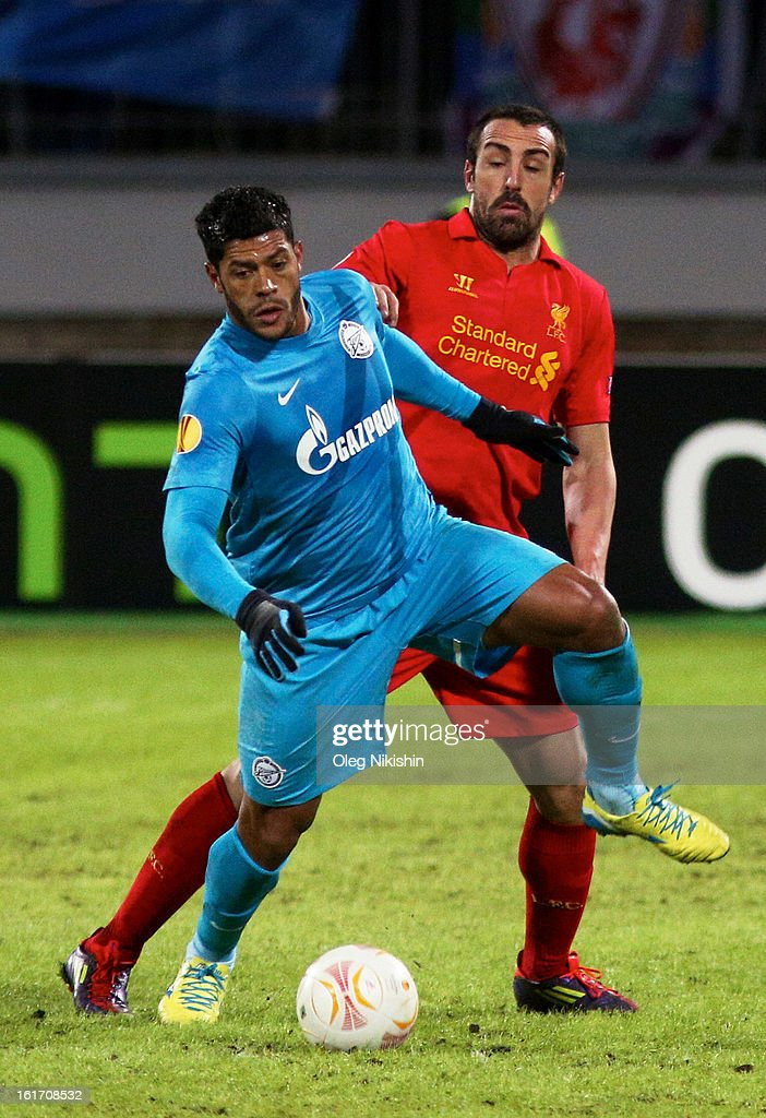 Hulk of FC Zenit St Petersburg battles for the ball with Jose Enrique of Liverpool FC during UEFA Europa League Round of 32 first leg match between FC Zenit St Petersburg and Liverpool at the 'Petrovski' stadium on February 14, 2013 in St. Petersburg, Russia.