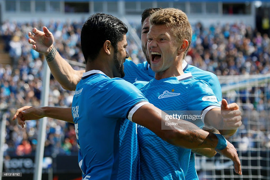 Hulk (L) of FC Zenit St. Petersburg celebrates his goal with Oleg Shatov (R) of FC Zenit St. Petersburg during the Russian Football League match between FC Zenit St. Petersburg and FC Dinamo Moscow at the Petrovsky stadium on July 19, 2015 in St. Petersburg, Russia.