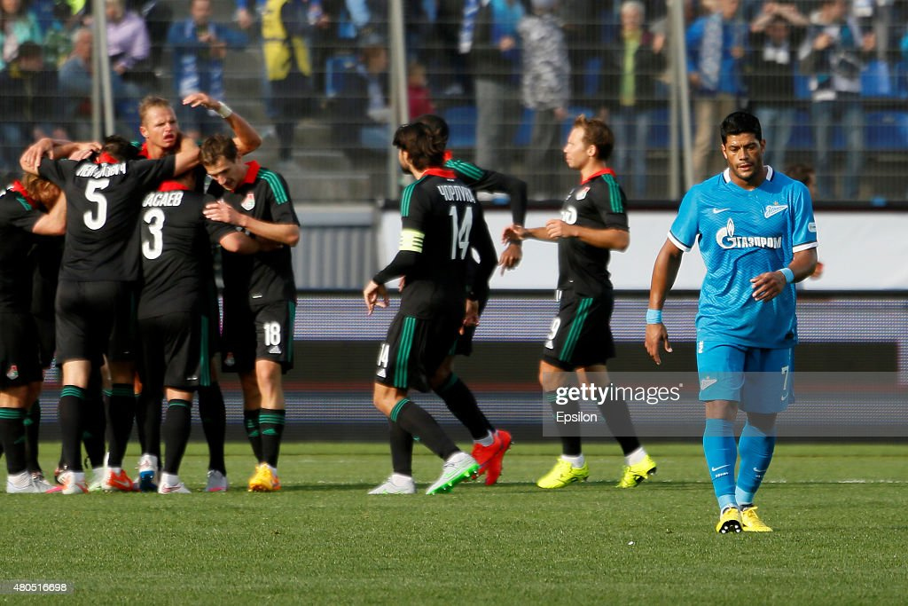 <a gi-track='captionPersonalityLinkClicked' href=/galleries/search?phrase=Hulk+-+Soccer+Player&family=editorial&specificpeople=7359350 ng-click='$event.stopPropagation()'>Hulk</a> (R) of FC Zenit St. Petersburg reacts as FC Lokomotiv Moscow players celebrate a goal during the Super Cup of Russia 2015 match between FC Zenit St. Petersburg and FC Lokomotiv Moscow at the Petrovsky stadium on July 12, 2015 in St. Petersburg, Russia.