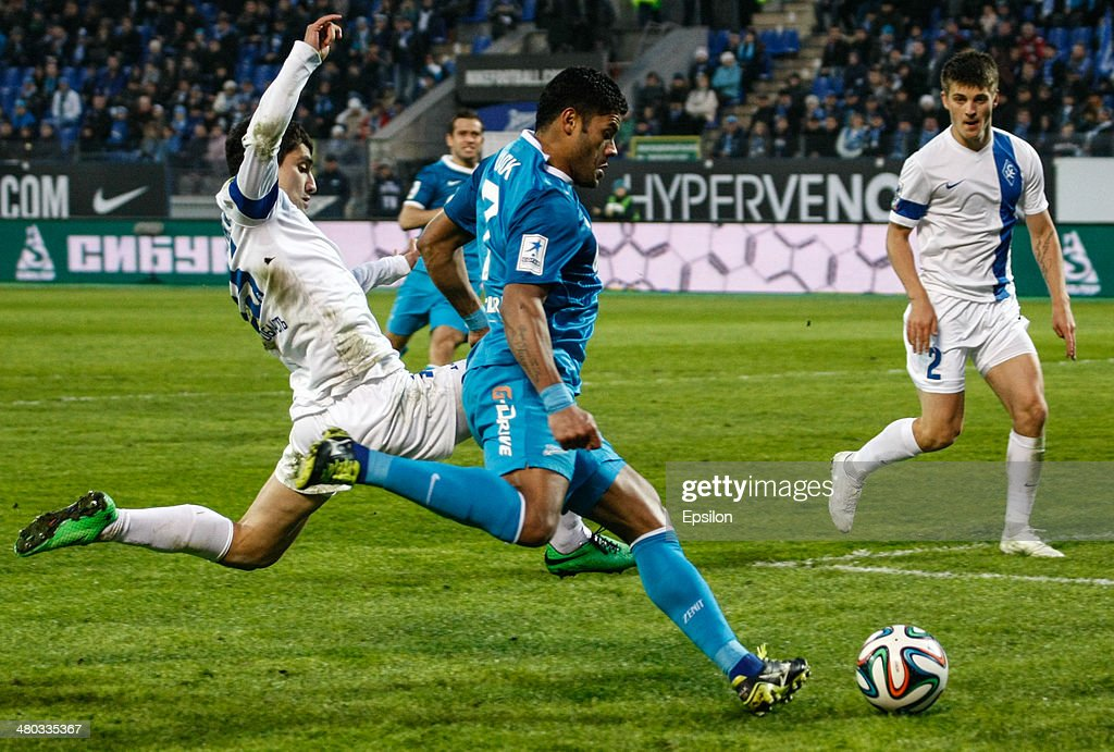 Hulk of FC Zenit St. Petersburg (R) shoots to score a goal during the Russian Football League Championship match between FC Zenit St. Petersburg and FC Krylia Sovetov Samara at the Petrovsky stadium on March 24, 2014 in St. Petersburg, Russia.