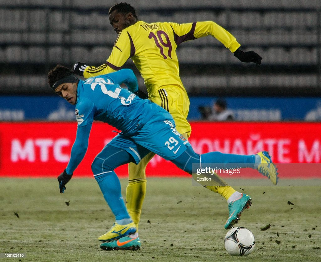 Hulk of FC Zenit St. Petersburg (L) vies for the ball with Lacina Traore of FC Anzhi Makhachkala during the Russian Premier League match between FC Zenit St. Petersburg and FC Anzhi Makhachkala at the Petrovsky Stadium on December 10, 2012 in St. Petersburg, Russia.