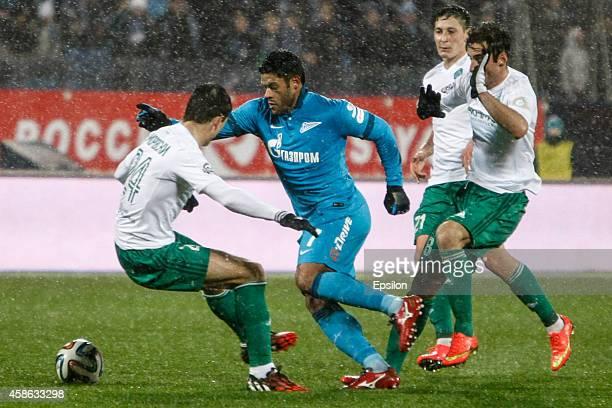 Hulk of FC Zenit St Petersburg vies for the ball with Marcin Komorowski of FC Terek Grozny Mauricio of FC Terek Grozny and Daler Kuzyayev of FC Terek...