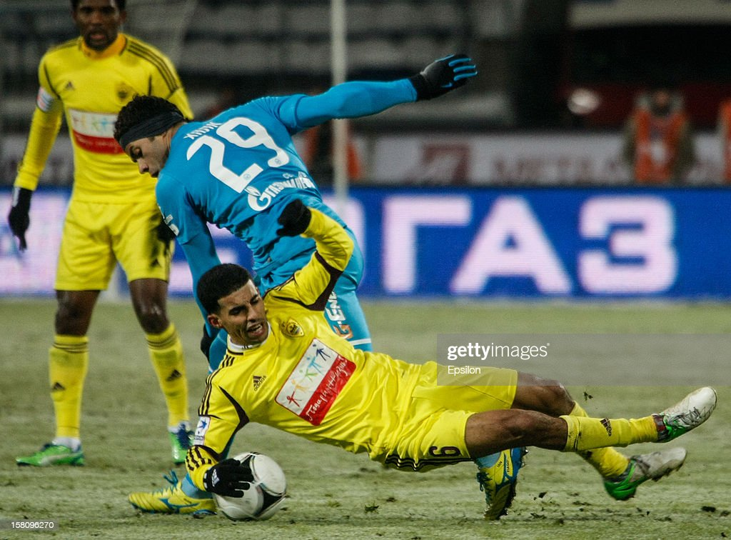 Hulk of FC Zenit St. Petersburg #29 vies for the ball with Mbark Boussoufa of FC Anzhi Makhachkala during the Russian Premier League match between FC Zenit St. Petersburg and FC Anzhi Makhachkala at the Petrovsky Stadium on December 10, 2012 in St. Petersburg, Russia.