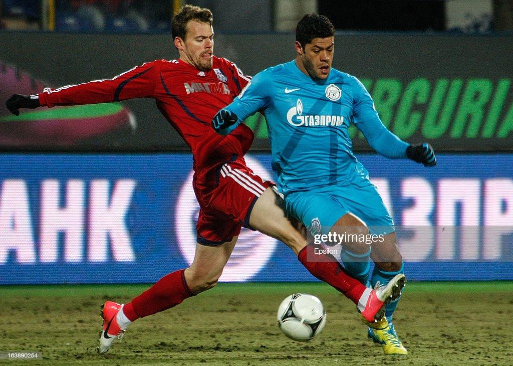 Hulk of FC Zenit St. Petersburg (R) vies for the ball with Tomislav Dujmovic of FC Mordovia Saransk during the Russian Football League Championship match between FC Zenit St. Petersburg and FC Mordovia Saransk at the Petrovsky Stadium on March 17, 2013 in St. Petersburg, Russia.