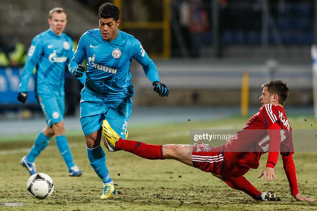 Hulk of FC Zenit St. Petersburg (2nd L) vies for the ball with Vladimir Bozovic of FC Mordovia Saransk during the Russian Football League Championship match between FC Zenit St. Petersburg and FC Mordovia Saransk at the Petrovsky Stadium on March 17, 2013 in St. Petersburg, Russia.