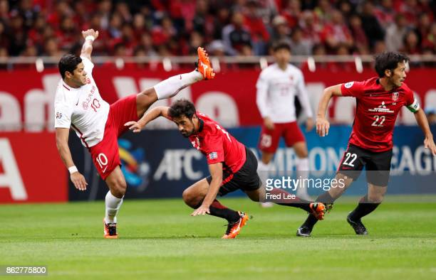 Hulk of Shanghai SIPG and Mauricio de Carvalho Antonio and Abe Yuki of Urawa Red Diamonds compete for the ball during the AFC Champions League semi...