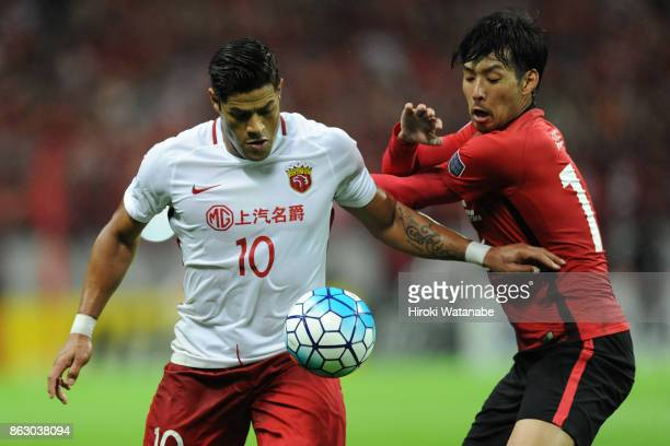Hulk of Shanghai SIPG and Takuya Aoki of Urawa Red Diamonds compete for the ball during the AFC Champions League semi final second leg match between...