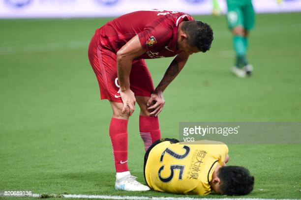 Hulk of Shanghai SIPG and Zou Zheng of Guangzhou Evergrande react during the 18th round match of 2017 Chinese Football Association Super League...