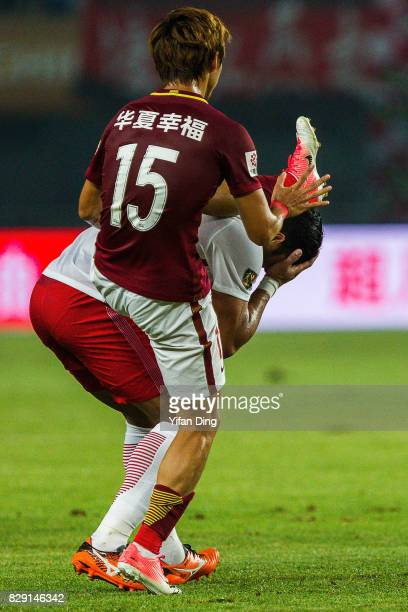 Hulk of Shanghai SIPG fouled by Yin Hongbo of Hebei China Fortune during the China Super League match between Hebei China Fortune and Shanghai SIPG...