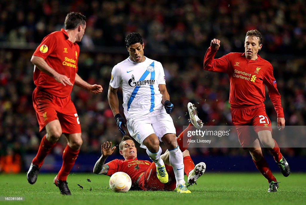 Hulk of Zenit charges through the liverpool defence of <a gi-track='captionPersonalityLinkClicked' href=/galleries/search?phrase=Jamie+Carragher&family=editorial&specificpeople=206485 ng-click='$event.stopPropagation()'>Jamie Carragher</a>, <a gi-track='captionPersonalityLinkClicked' href=/galleries/search?phrase=Daniel+Agger&family=editorial&specificpeople=605441 ng-click='$event.stopPropagation()'>Daniel Agger</a> and Lucas of Liverpool during the UEFA Europa League round of 32 second leg match between Liverpool FC and FC Zenit St Petersburg at Anfield on February 21, 2013 in Liverpool, England.