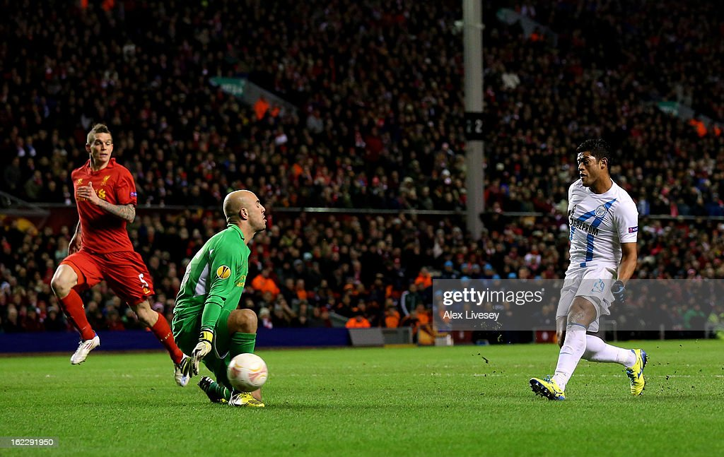 Hulk of Zenit scores the opening goal past goalkeeper Pepe Reina of Liverpool during the UEFA Europa League round of 32 second leg match between Liverpool FC and FC Zenit St Petersburg at Anfield on February 21, 2013 in Liverpool, England.