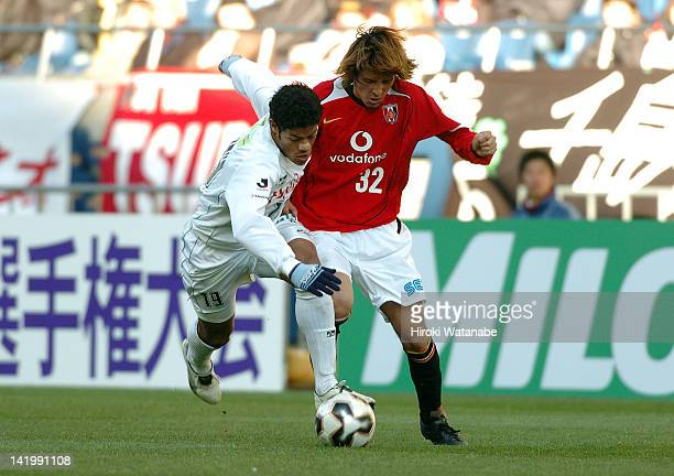 Hulk whose real name is Givanildo Vieira de Souza of Kawasaki Frontale and Hajime Hosogai of Urawa Red Diamonds compete for the ball during the 85th...