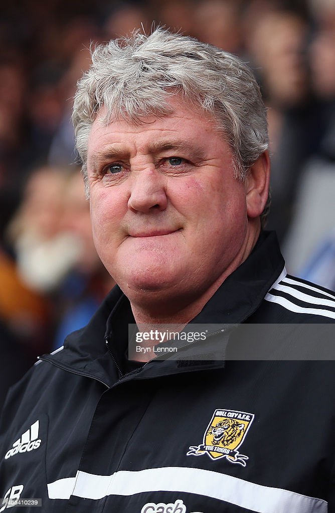 Hull City AFC Manager <a gi-track='captionPersonalityLinkClicked' href=/galleries/search?phrase=Steve+Bruce+-+Soccer+Manager&family=editorial&specificpeople=208832 ng-click='$event.stopPropagation()'>Steve Bruce</a> looks on prior to the FA Cup Fourth Round match between Southend United and Hull City at Roots Hall on January 25, 2014 in Southend, England.