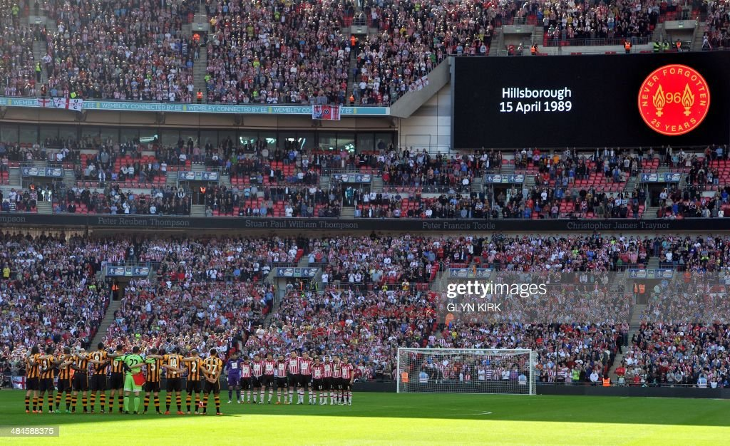 Hull City and Sheffield United players observe a minute of silence to mark the 25th anniversary for the Hillsborough disaster during the English FA Cup Semi-final match between Hull City and Sheffield United at Wembley Stadium in London on April 13, 2014.