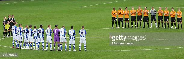 Hull City and Sheffield Wednesday players show their respect to Motherwell captain Phil O'Donnell who played for Sheffield Wednesday in a minute...