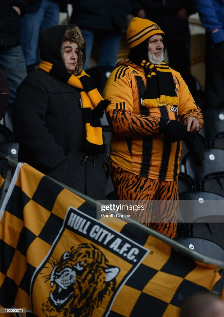 Hull City fans watch on during the FA Cup Fourth Round between Hull City and Barnsley at KC Stadium on January 26, 2013 in Hull, England.