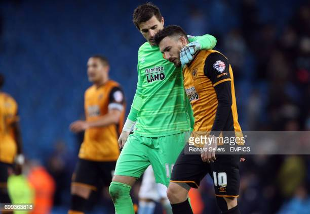Hull City goalkeeper Eldin Jakupovic consoles Hull City's Robert Snodgrass after defeat