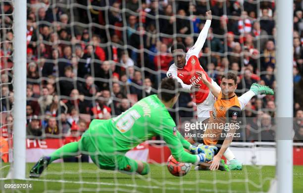 Hull City goalkeeper Eldin Jakupovic saves from Arsenal's Danny Welbeck