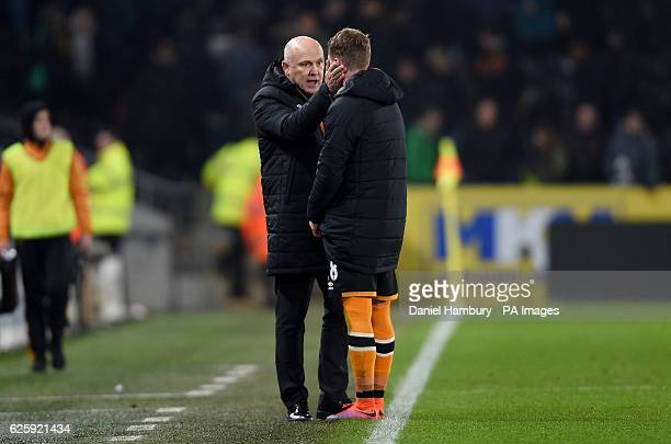 Hull City manager Mike Phelan and Josh Tymon on the touchline during the Premier League match at the KCOM Stadium Hull
