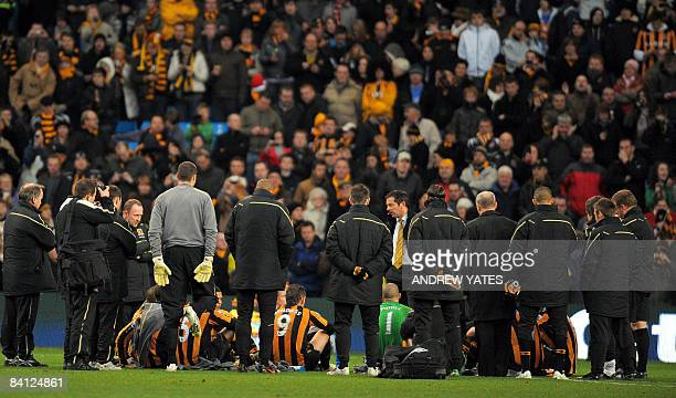 Hull City manager Phil Brown delibers his half time team talk on the pitch during the English Premier league football match against Manchester City...